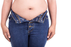 Fat woman trying to wear jeans : Fat and Healthy concept Royalty Free Stock Photo