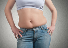 Fat woman. On wall background Stock Photo