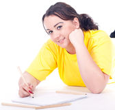 Fat woman writing on blank card Royalty Free Stock Photography