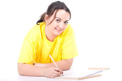 Fat woman writing on blank card Stock Photography