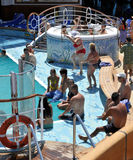 Fat women dance on poolside. Of cruise ship Crown Princess Royalty Free Stock Image