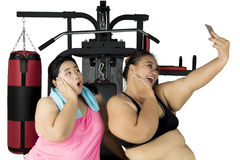 Fat women taking selfie in the center gym Royalty Free Stock Photo