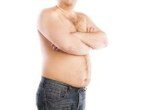 Fat young man. Belly detail of fat young man. Studio portrait on white background Royalty Free Stock Photography