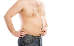 Fat young man. Belly detail of fat young man. Studio portrait on white background Royalty Free Stock Images