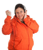 Fat young woman with headphones and mp3 player Stock Photography
