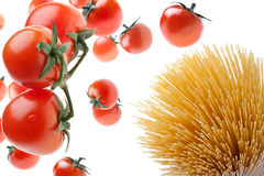 Fatal Attraction. Tomatoes falling on spaghetti: it's a fatal attraction Royalty Free Stock Photos