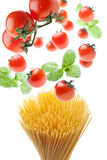 Fatal Attraction: spaghetti, tomatoes and basil. Tomatoes and basil falling on spaghetti: it's a fatal attraction Royalty Free Stock Photos