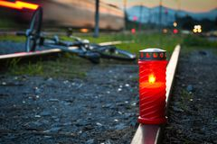 Fatal bicyclist and train crash accident. When crossing rail road. Train accident with red candle and broken bicycle lying on the metal rail track stock photo