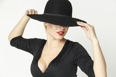Fatal girl in a hat royalty free stock photography