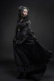 Fatal woman in vintage black dress Stock Photo