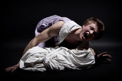 Fatality. The young man in a female dress over the plaster cast wrapped by a white fabric Stock Photos