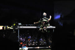 Fatboy Slim mixing live in the front of a crowd of people Royalty Free Stock Photos