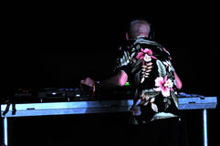 Fatboy Slim mixing live in the front of a crowd of people Stock Photography