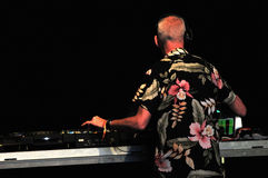 Fatboy Slim mixing live in the front of a crowd of people Royalty Free Stock Images