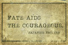 Fate aids JP. Fate aids the courageous - ancient Japanese proverb printed on grunge vintage cardboard Stock Photography