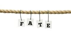 Fate. Word - Fate - suspended from a rope with each individual letter attached by a wire Stock Image