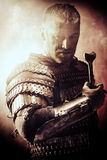 Fateful moment. Portrait of a courageous ancient warrior in armor with sword Royalty Free Stock Images