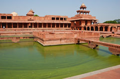 Fatehpur Sikri, India. A ornamental pool with a central platform and four bridges in Fatehpur Sikri, India. Photo taken on September 21, 2011 Royalty Free Stock Images