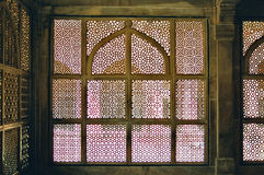Fatehpur Sikri Jain architecture, India. A chamber with a decorative Jain architecture window, designed to provide shade and breeze, Fatehpur Sikri, India stock image
