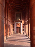 Fatehpur Sikri Red column corridor, India. Fatehpur Sikri is the historical city was constructed by Mughal emperor Akbar Stock Photos