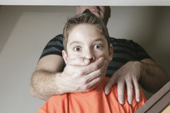 Father abused his young boy at home Stock Photos