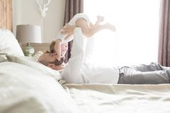 Father with adorable baby toddler on bed. A Father with adorable baby toddler on bed Stock Images