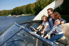 Father with adorable daughter and wife resting on big boat royalty free stock photos