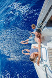 Father with adorable kids resting on yacht Stock Images