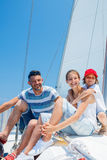 Father with adorable kids resting on yacht Stock Photo