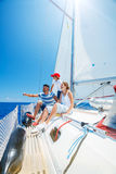 Father with adorable kids resting on yacht. Happy father with adorable daughter and son resting on a big yacht Royalty Free Stock Photography