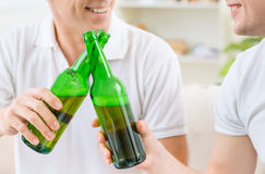 Father and adult son drinking beer Stock Photos
