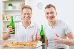 Father and adult son drinking beer Royalty Free Stock Image