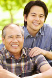 Father and adult son outdoors Stock Photo