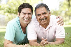 Father With Adult Son In Park. Smiling To Camera Stock Photos