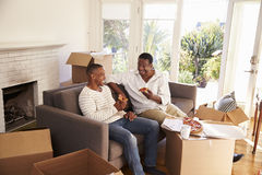 Father And Adult Son Take A Break With Pizza On Moving Day Royalty Free Stock Photo