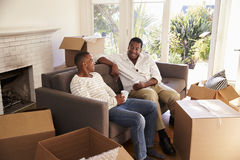 Father And Adult Son Take A Break With Pizza On Moving Day Stock Photo