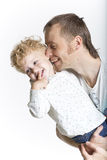 Father is affectionately kissing his son. Father is kissing his son isolated on white stock image