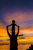 Father And Child On Sunset Sea Background Royalty Free Stock Photography