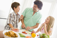 Father And Children Prepare A Meal Stock Image
