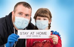 Free Father And Daughter Holding Poster `Stay At Home` Message Stock Photo - 175645930