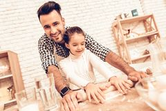 Free Father And Daughter Roll Dough With Rolling Pin. Royalty Free Stock Photography - 131404567