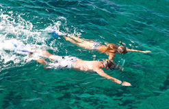 Father And Daughter Snorkeling In Tropics Stock Image