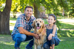 Free Father And Daughter With Their Pet Dog In The Park Stock Photo - 53854240
