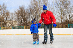 Free Father And Little Son Learning To Skate In Winter Stock Photo - 66019340