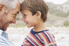 Free Father And Son (5-6) Touching Foreheads On Beach Close-up Stock Photo - 191842780