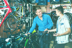 Father And Son Choosing Wheel Royalty Free Stock Images