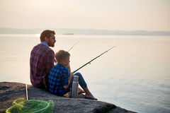 Father And Son Fishing At Sunset Stock Images