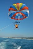 Father And Son Fly On A Parachute Over The Sea Royalty Free Stock Photos