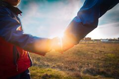 Free Father And Son Holding Hands At Sunset, Parenting Royalty Free Stock Photos - 181956758