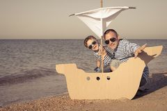 Free Father And Son Playing On The Beach At The Day Time Royalty Free Stock Photos - 136714408